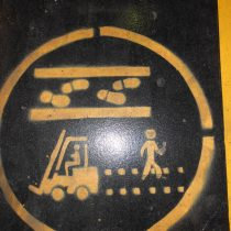 A hazard warning sign showing where people should walk in an area where fork lift trucks operate 2013.