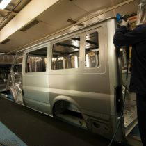 A worker sanding trim on a Transit body in the production line 2013.